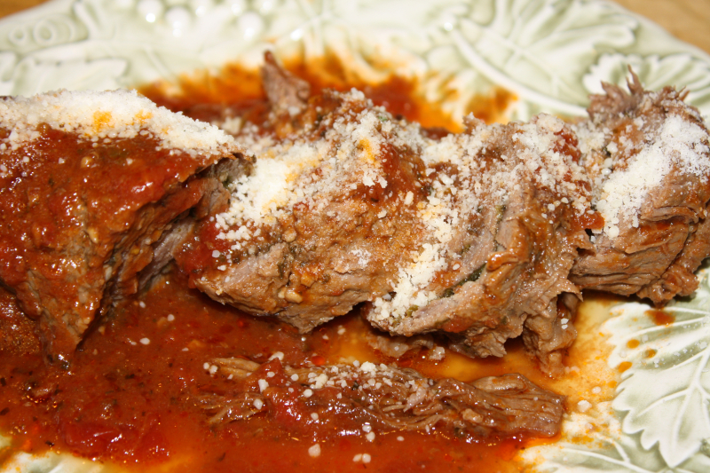 Braciole topped wiht fresh grated cheese